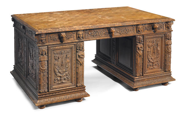 A Continental Renaissance Revival carved walnut partners desk