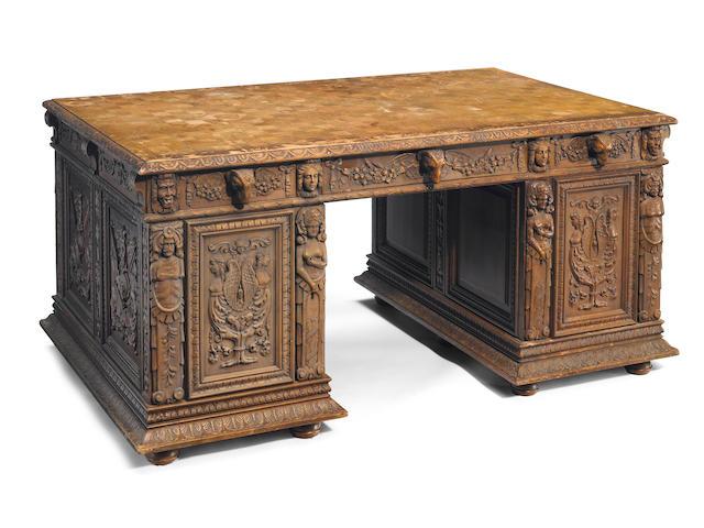 A Continental Renaissance Revival carved walnut partners desk
