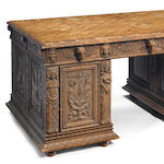 A Continental Renaissance Revival carved walnut pedestal partners' desk