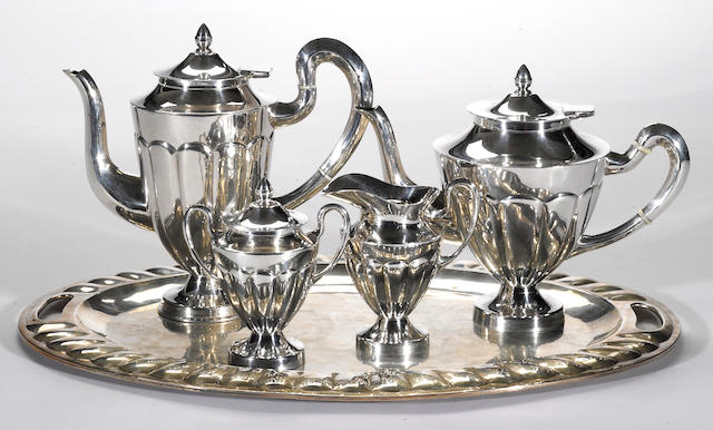 A Mexican sterling four piece tea and coffee set with matching tray L. Maciel, Mexico City  (5)