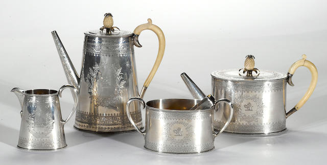 A Victorian silver four piece tea and coffee set in the George III taste with associated pair of Georgian silver sugar tongs A. B. Savory & Sons/Goldsmiths Alliance Limited, Cornhill, London, 1880<BR />Cornelius Bland, London, 1795 <BR />Set with crest  (5)