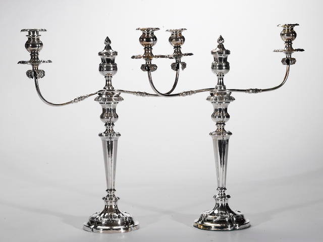 A Sheffield plate pair of two arm-three light candelabra with finials Early 19th century  (2)