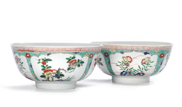 A pair of famille verte enameled porcelain bowls with floral blossom reserves  Kangxi period diameter 6in