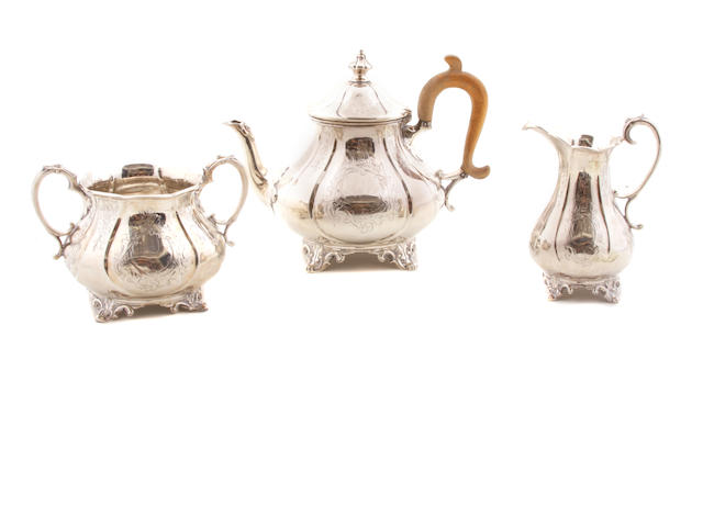 A Victorian sterling silver three piece tea service William Hunter, London,  1860