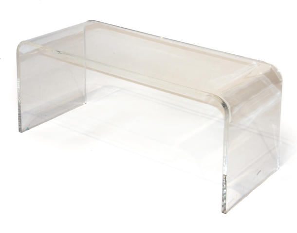 A contemporary acrylic horseshoe form side table  fourth quarter 20th century