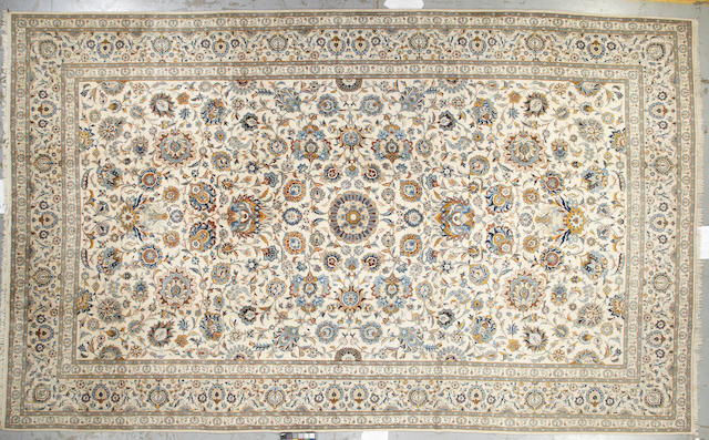 A Kashan carpet Central Persia, Size approximately 18ft 8in x 11ft 4in