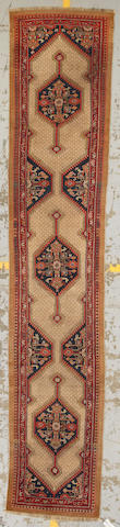 A Malayer runner Central Persia, size approximately 2ft. 9in. x 14ft. 6in.
