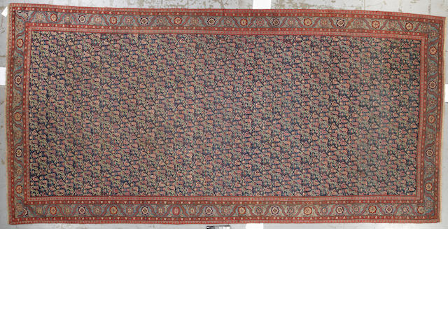 A Karabagh carpet size approximately 8ft. 2in. x 17ft. 7in.
