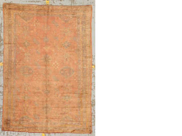 An Oushak carpet West Anatolia size approximately 6ft. 5in. x 9ft. 2in.