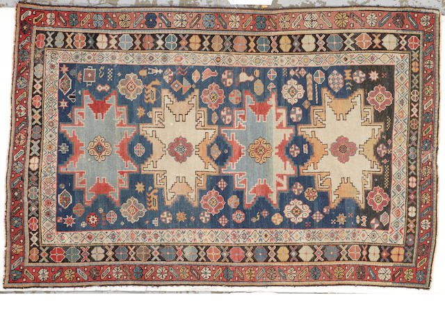 A Kuba rug size approximately 4ft. x 6ft. 1in.