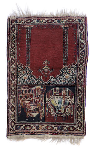 A pictorial Kerman rug size approximately 2ft. 2in. x 3ft.