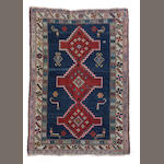 A Caucasian rug size approximately 3ft.9in. x 5ft. 6in.