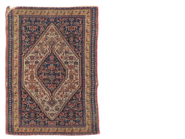 A Senneh rug size approximately 3ft. x 2ft.