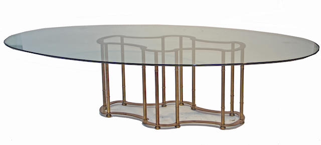 A contemporary glass and brass dining table late 20th century