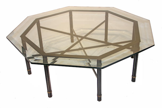 A contemporary octagonal glass and metal coffee table