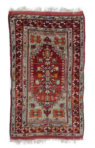 A Turkish rug size approximately 46ft. 1in. x 10ft. 2in.