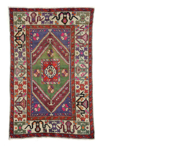 A Turkish rug size approximately 4ft. 8in. x 8ft. 6in.