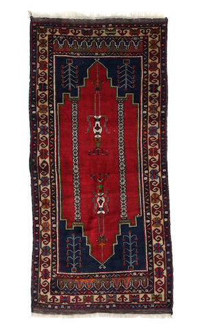 A Bakhtiari carpet size approximately 4ft. 3in. x 8ft. 4in.
