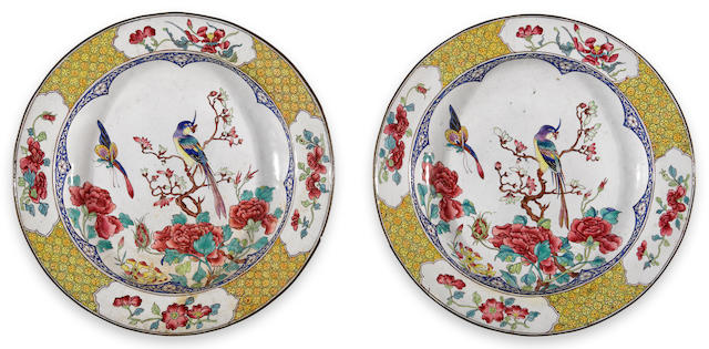 A pair of ruby backed Canton enameled metal deep dishes Qianlong period