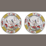A pair of ruby backed Canton enameled deep dishes with flower and bird decoration Qianlong period diameter 8 ¼in (soiling, restoration, cracks)