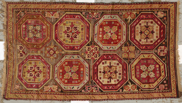 A Karabagh carpet size approximately 3ft. 10in. x 6ft. 8in.