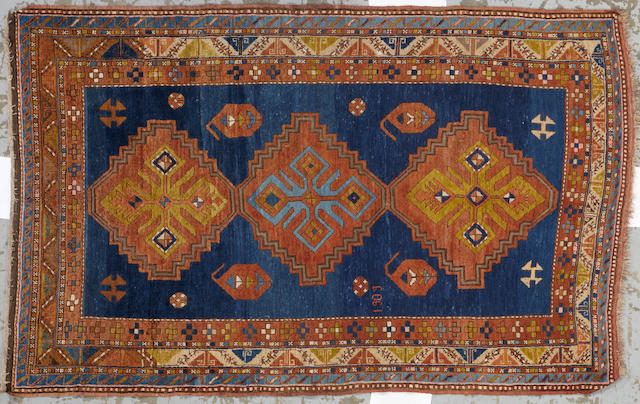 A Kazak rug Caucasus size approximately 4ft. 7in. x 7ft. 4in.