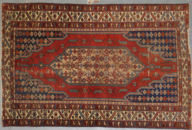 A Mazlaghan rug approximately 3ft. 10in. x 3ft.