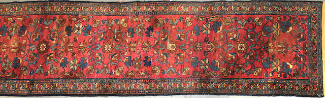A Hamadan runner size approximately 2ft. 7in. x 16ft.