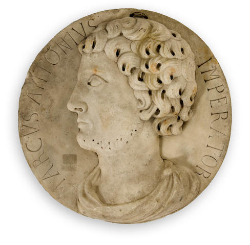 A classical style marble roundel with relief profile 19th/20th century