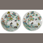 A pair of famille verte enameled porcelain chargers with wide rim flanges, decorated with birds, flowers, and branches Kangxi period diameter 13 ¼in (rims retouched)