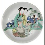 A famille verte enameled porcelain deep dish with two beauties  Kangxi period diameter 11in (two hairline cracks)