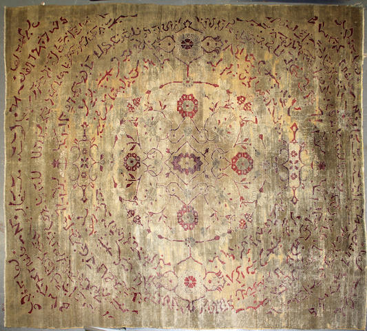 An Agra carpet size approximately 9ft. 5in. x 11ft. 9in.