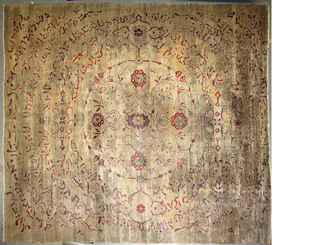 An Agra carpet  approximately 9ft. 5in. x 11ft. 9in.