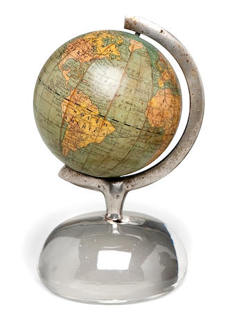 A 3-inch terrestrial globe<BR /> 1891 6 x 3-1/2 in. (15.2 x 8.8 cm.) height by overall diameter.