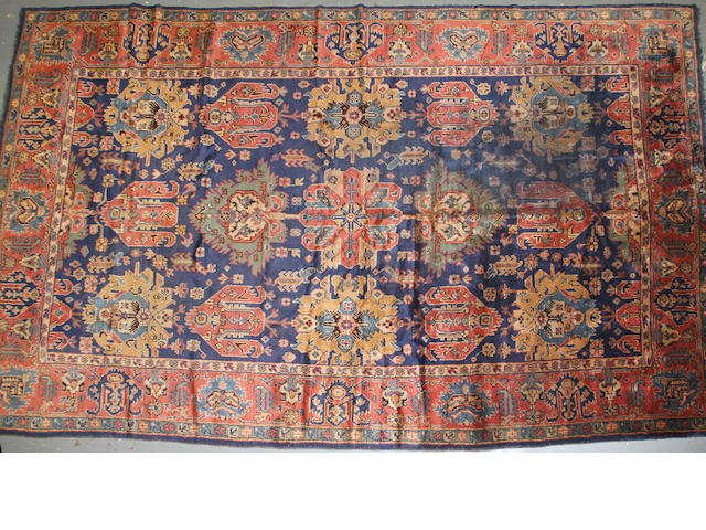 An Oushak carpet  size approximately 8ft. 10in. x 14ft. 3in.