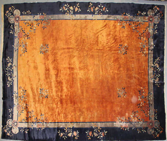 A Chinese carpet size approximately 9ft. 3in. x 11ft. 4in.