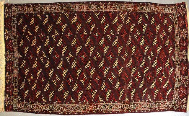 A Turkoman carpet size approximately 6ft. 9in. x 11ft. 3in.
