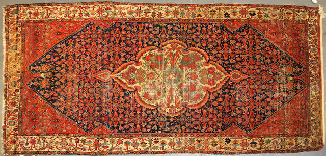 A Hamadan carpet size approximately 5ft. 6in. x 11ft.