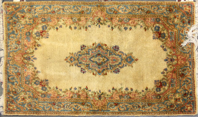 A Kerman carpet size approximately 3ft. x 5ft.