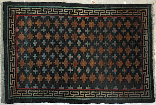 A Tibetan rug size approximately 3ft. x 5ft. 4in.