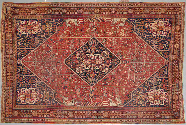 A Shiraz rug size approximately 4ft. 6in. x 7ft. 6in.