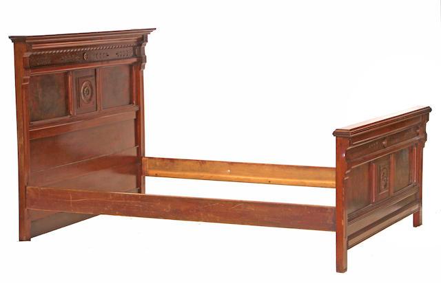 An American Victorian Eastlake mahogany bed circa 1875