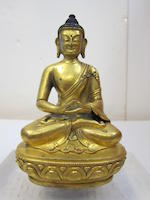 A Tibeto-Chinese gilt copper alloy seated figure of the Buddha 18th/19th century