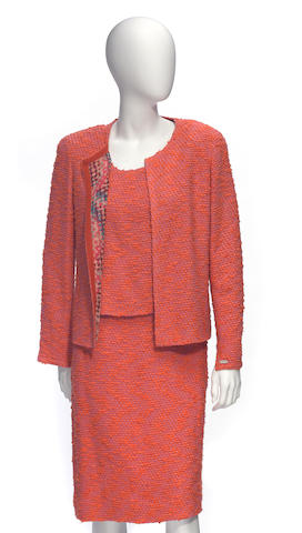 A Chanel orange and pink bouclé shell and skirt suit