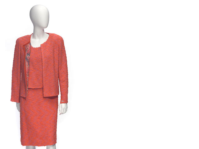A Chanel boucle orange and pink, shell and skirt suit