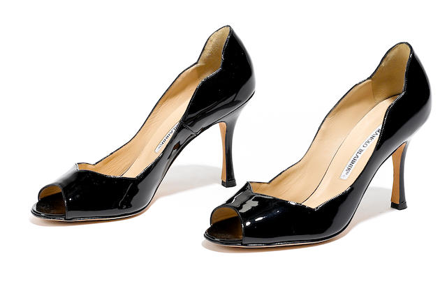A pair of Manolo Blahnik black patent leather stilettos