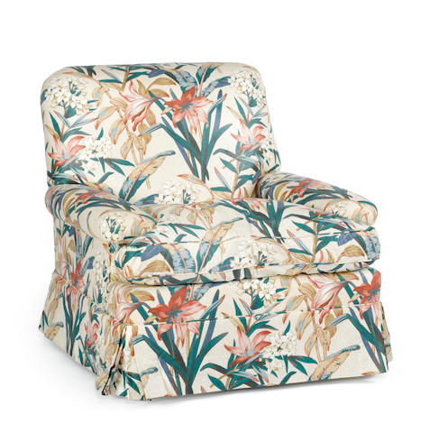 A contemporary lily and floral chintz upholstered club chair