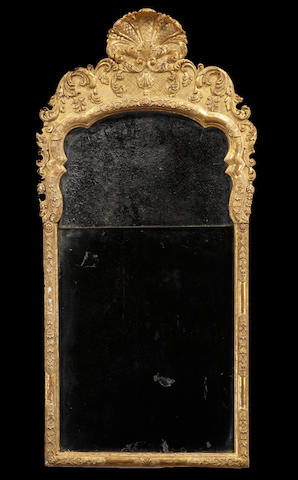 A George I giltwood and gilt gesso mirror<BR />early 18th century