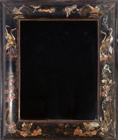 A Continental Baroque chinoiserie decorated and ebonized mirror   probably Dutch  early 18th century
