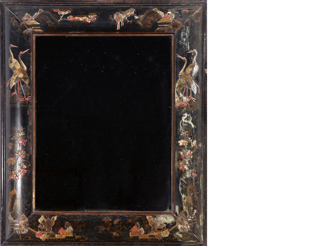 A Continental Baroque chinoiserie decorated and ebonized rectangular mirror with later plate probably Dutch, early 18th century